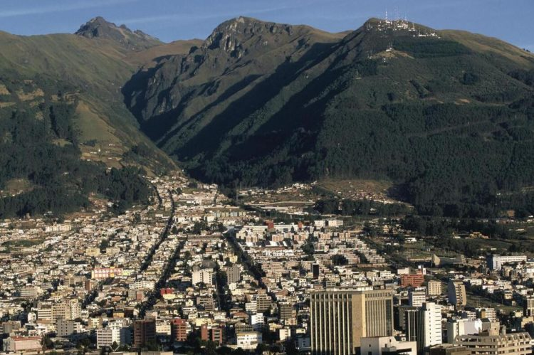 Quito is one of the two largest cities in Ecuador. The picture shows a view of the city, with Pichincha volcano in the background.